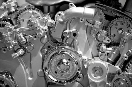 Modern Gasoline Engine Technology. Metal Shiny Car Engine Closeup Photography.