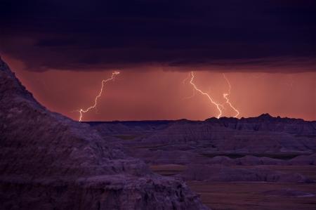 lightnings: Lightnings Storm. Summer Storm in the Badlands National Park, South Dakota, USA. Three Lightnings on the Horizon. Powerful Nature Photo Collection. Stock Photo