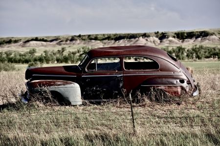 Clunker on Prairie near Pine Ridge Indian Reservation in South Dakota. Abandoned Car in South Dakota.  photo