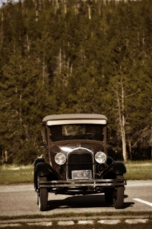 oldish: American Oldtimer. Old Car on the Parking. Sepia Colors Vertical Photo. Vintage Transportation Photo Collection. Stock Photo