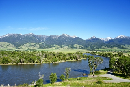 rivers mountains: Yellowstone River Near Livingston, Montana, U.S.A. Montana Landscape with Yellowstone River, Mountains Range with Snowy Peaks and Clear Blue Sky. Nature Photo Collection.