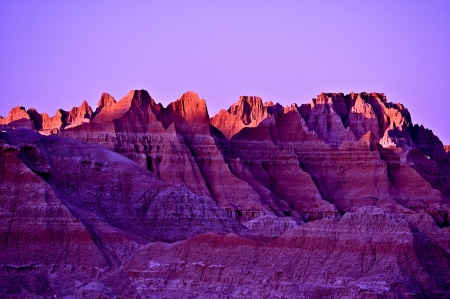 natural wonders: Sunset Scenery in the Badlands, South Dakota. Sun Illuminating Badlands Sandstones Peaks. Nature Photo Collection.