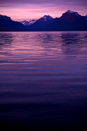 waters: Lake McDonald Sunset. Lake McDonald in Glacier National Park. Vertical Photography. Montana Photo Collection.