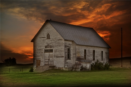 Rustic Prairie Building - Somewhere in Western South Dakota State, USA. Old Wood City Building in the Center of Nowhere. Sunset Sky in a Background. HDR-Like Composition.