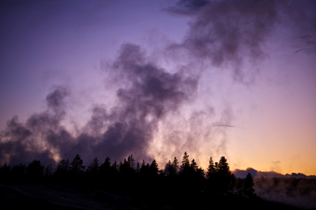geysers: Yellowstone Geysers - Yellowstone National Park Sunset. Wyoming, USA. Steaming Geysers Landscape. Nature Photo Collection.