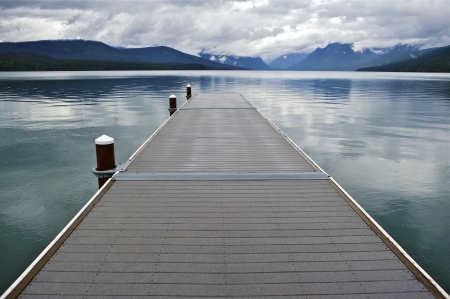 the long lake: Lake McDonald Montanas Glacier National Park. Wood Floating Dock. Lake McDonald is the Largest Lake in Glacier National Park. About 16 Miles Long and a Mile Wide and Up To 470ft in Deep. Nature Photo Collection