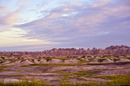 erode: Badlands Horizon During Sunset. Prairies and Sandstones Formations of Badlands National Park. Nature Photo Collection. Stock Photo