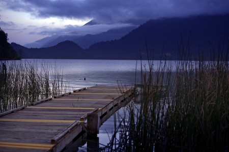 crescent lake: Wood Dock and the Boat. Lake Crescent at Evening. Washington State, USA. Olympic National Park. Recreation Photography Collection