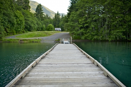 crescent lake: Wood Boat Dock on Lake Crescent, Washington State, USA. Dark Green Super Clean Lake Water. Olympic National Park