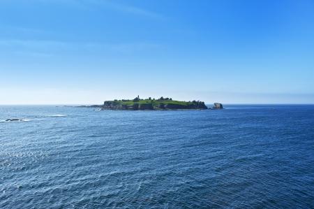 flattery: Lighthouse Island - Tatoosh Island - Cape Flattery Lighthouse. Cape Flattery Lighthouse was built in 1854. Washington State, U.S.A. Washington State Photography Collection. Stock Photo
