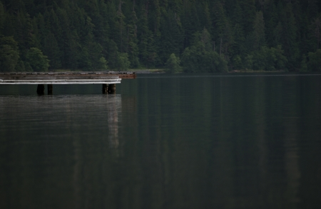 crescent lake: Lonely Lake Place - Wood Dock Through the Lake. Recreation Theme. Lake Crescent, Washington State, USA.