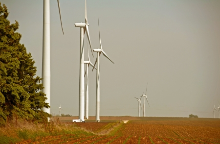 windy energy: Servicing Wind Turbines. Wind Energy Plantation. Power Industry Photography Collection. Stock Photo