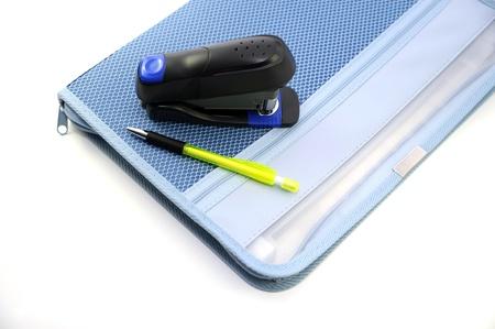 office stapler: Blue Case Stapler and Pen Isolated on White. Office Theme. Stock Photo