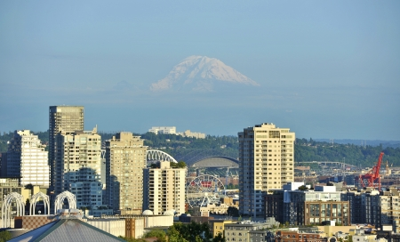 Mt Rainier and Seattle. City of Seattle - Mount Rainier Dominates the Horizon. Washington State, USA. Cities Photo Collection. photo