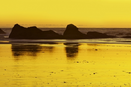 Ocean Sunset Scenery - Sandy Beach with Rock Formations. Nature Photo Collection. photo