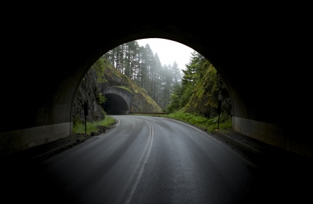 Mountain Tunnels. View From Tunnel on Another Tunnel Entrance. Paved Mountain Road. sports competition National Park, Washington State, USA - Hurricane Ridge Road.