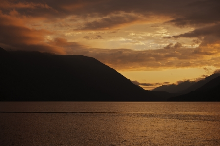 Sunset Sky Over the Lake. Lake Crescent, Washington, USA.  photo