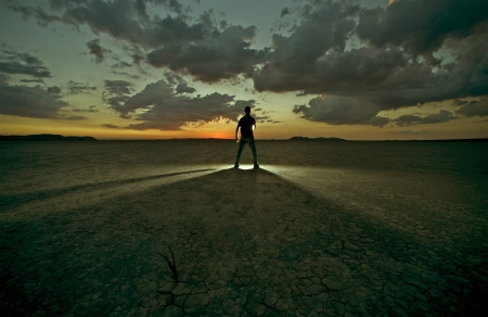 Drought Confrontation / Men in Light - Men in Front of Some Mystique Light on Desert. Creative Photography Photo Collection. Stock Photo - 15025183