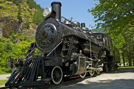 locomotora: Antigua Locomotora de vapor Occidental - Exposición Histórica locomotora del ferrocarril. Estado de Washington, EE.UU.. Transporte Colección de fotografías. Editorial