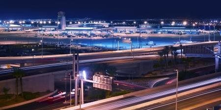 landing light: Vegas Transportation System - Las Vegas Airport and Highways System at Night. Transportation Photography Collection. Las Vegas, Nevada, U.S.A.