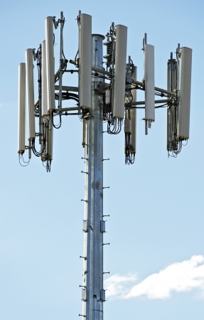 Modern Cellular Tower - Communication Tower on Blue Sky. Vertical Photography.