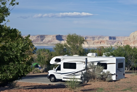 recreational area: RVing in Arizona. Class C Recreation Vehicle with Opened Side Slider in Page, Arizona, USA. Glen Canyon Recreation Area  Lake Powell. Recreation Photo Collection.