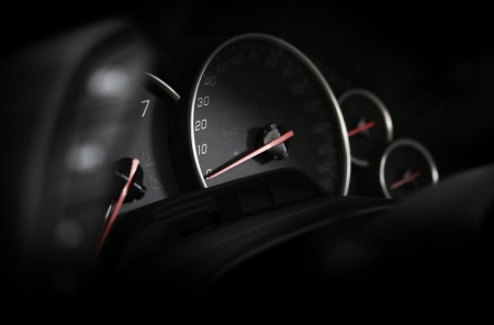 Car Dashboard - Vehicle Instruments. Speedometer in the Dark. Motorsport Theme. Cool Ambient Light. Transportation Photo Collection.