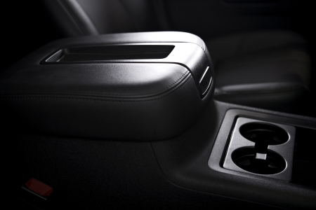 holder: Armrest and Cups Holder - Modern Vehicle Interior. SUV Armrest. Transportation Photo Collection.