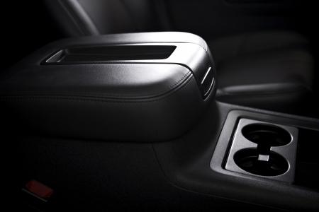 Armrest and Cups Holder - Modern Vehicle Interior. SUV Armrest. Transportation Photo Collection. Stock Photo