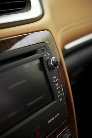 In-Dash Car Audio System Details Photo. Modern Vehicle Leather Interior. Vertical Studio Photography. Transportation Photo Collection.
