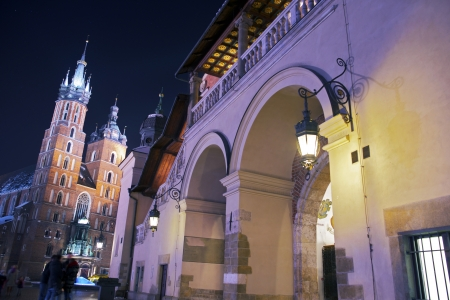 Krakow Sukiennice and St. Marys Basilica on the Left - Cracow Main Square at Night.  Krakow, Poland. Cities Photography Collection. photo