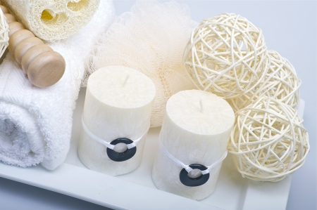SPA Accessories. Fresh White Towels, Candles and Decoration Elements. Health and Beauty Theme. photo