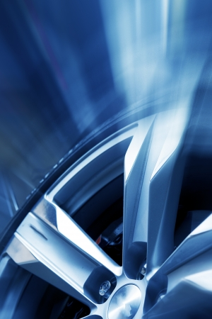 Rims and Tires Background. Cool Elegant Aluminium Wheel - Action Blue Background. Great For Motorsport  Racing Events or Tire  Rims Sales Companies. Transportation Collection. Vertical Theme Stock Photo