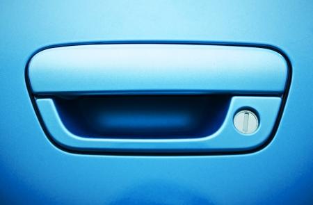 Blue Car Door Handle Closeup. Vehicle Handle Details. Transportation Photo Collection. photo