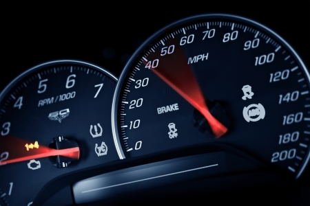 Sporty Speedometer. Sports Car Instruments DashPanel Closeup. RPM and Speed Metering. Transportation Photo Collection.
