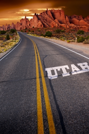Welcome in Utah - Trip to Utah. Utah State Rocky Sandstones Landscape and the Highway with Sign Utah on it. US Travels Photo Collection.
