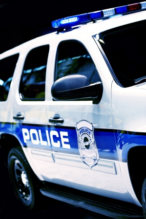 Police Car SUV Partial - Police Cruiser on Black Background. Transportation and Traffic Safety Photo Collection. Stock Photo