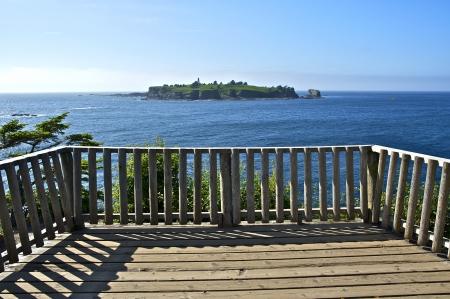 flattery: Lighthouse Island - Tatoosh Island  Viewpoint. Cape Flattery Lighthouse in a Distance. Washington State, U.S.A. Pacific Northwest Photography Collection. Stock Photo