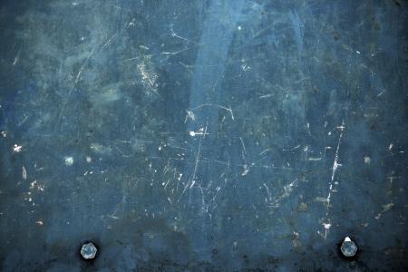 oxidado: Fondo azul del metal oxidado con dos pernos. Metal sucio Fondos Collection.
