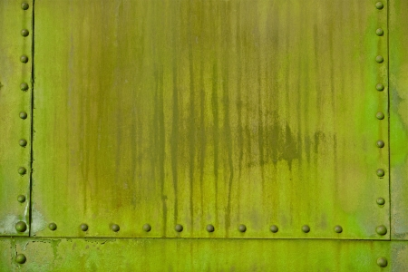 corroded: Green Metal and Rivets. Old Corroded Dirty Green Metal Wall Photo Background Stock Photo