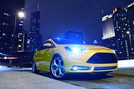 Performance Yellow Car in Downtown Chicago. Fast and Furious. Car at Night - Urban Theme. Performance Vehicles Photography Collection.