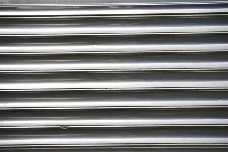 polished: Folded Polished Metal Photo Background. Stock Photo