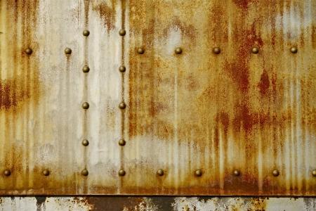さびた金属リベット写真の背景を持つ。厄介な背景コレクションです。