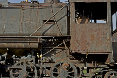 corroded: Corroded Small Steam Vintage Locomotive - Closeup Photo. Railroad Photography Collection.