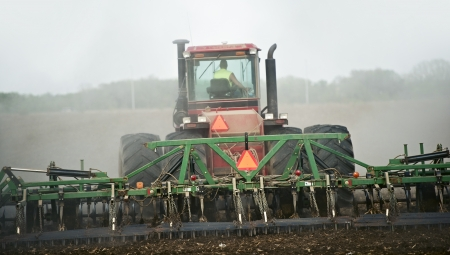 Agriculture Works - Heavy Duty Tractor Pulling Soil Finisher. Agriculture Cultivation Theme.  photo