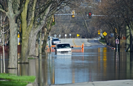 flood damage: Flooded City Streets. Van in the Water. Heavy Rain River Flood in Chicago Metro Area. Nature Disasters Photo Collection.
