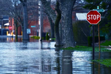 plains: Flooded Street of Des Plains City. Spring River Flood. Des Plains, IL, USA. Nature Disasters Photo Collection.