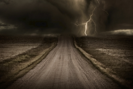 Stormy Back Country Road. Heavy Storm and Lightning Bolt in a Distans. Severe Weather Imagery Collection. photo
