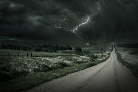 Country Storm. Back Country Gravel Road and Storm Ahead. Lightning Bolt in a Distance. Severe Weather Collection. photo