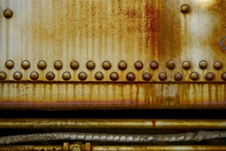 corroded: Rusty Industrial Background with Rusty Pipes and Cables. Corroded Metal with Rivets. Grungy Backgrounds Photo Collection.